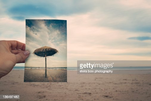 Summer umbrella in winter beach : Stock Photo