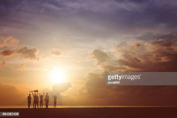 Summer vacation with friends: beach party at sunset