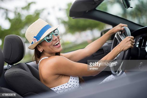 Summer woman driving a convertible car