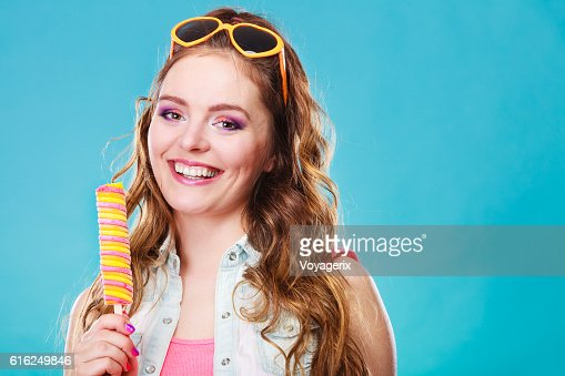 Summer woman eating popsicle ice pop cream : Stock Photo
