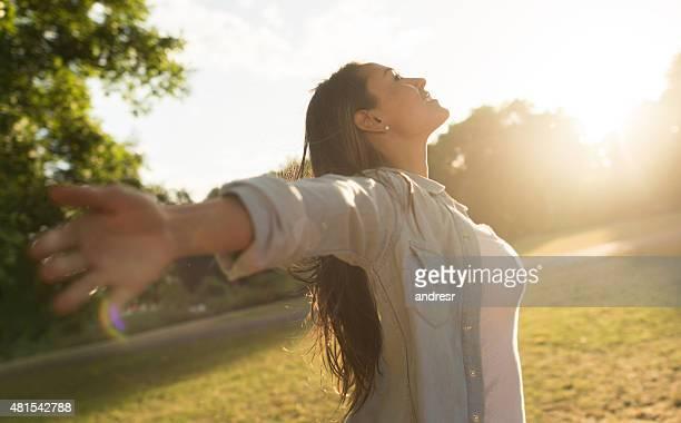 Summer woman enjoying some fresh air outdoors