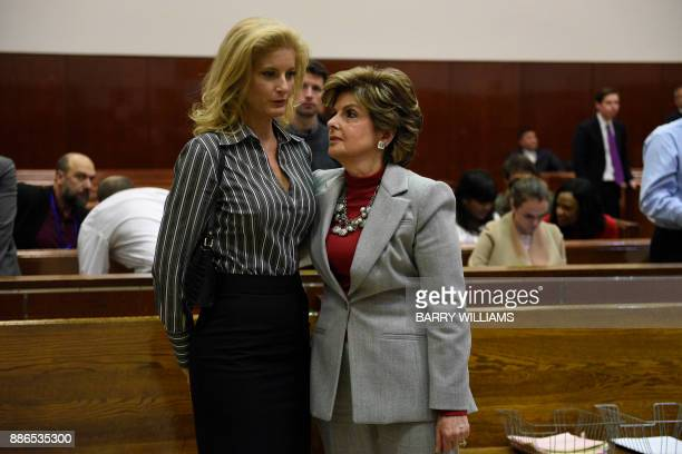 Summer Zervos a former contestant on the television show 'The Apprentice' listens to her lawyer Gloria Allred in New York County Criminal Court on...