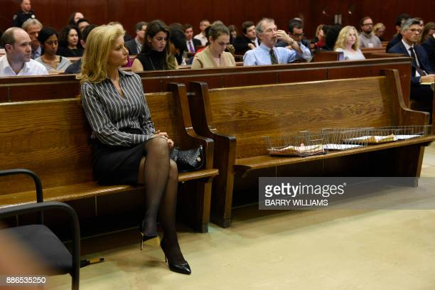 Summer Zervos a former contestant on the television show 'The Apprentice' sits in New York County Criminal Court on December 5 in New York during a...