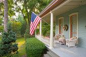 American Flag and a Quaint Victorian Style Veranda