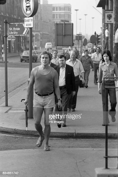 A summery outlook for freelance journalist John Wilson as he arrives at Fleet Street in shorts and vest as the heatwave in London continued