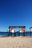 Summery shaded resting areas on beach, Greece