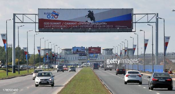 G20 summit banners hang over the road to Pulkovo airport outside Saint Petersburg on August 27 2013 The Group of 20 advanced and emerging nations...