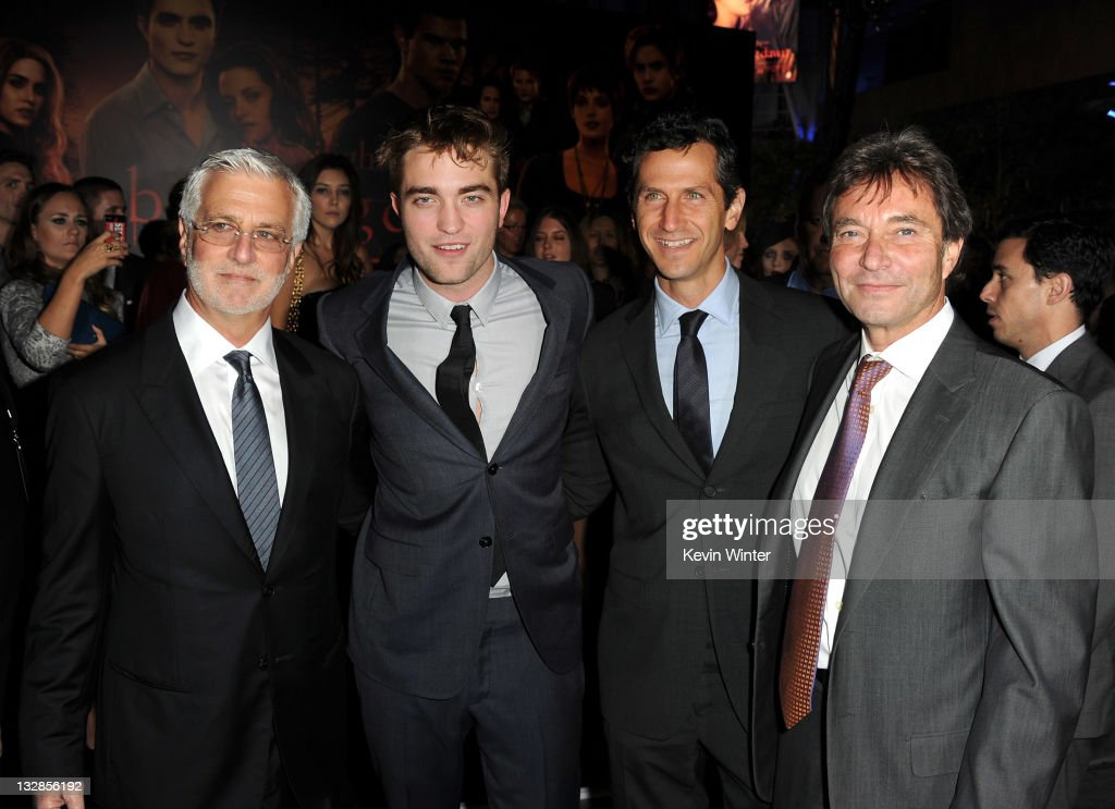 Summit Entertainment Co-Chairman Rob Friedman, actor Robert Pattinson, Summit Entertainment President of Worldwide Production and Acquisitions Erik Feig, and Summit Entertainment President & CEO Patrick Wachsberger arrive at the premiere of Summit Entertainment's 'The Twilight Saga: Breaking Dawn - Part 1' at Nokia Theatre L.A. Live on November 14, 2011 in Los Angeles, California.