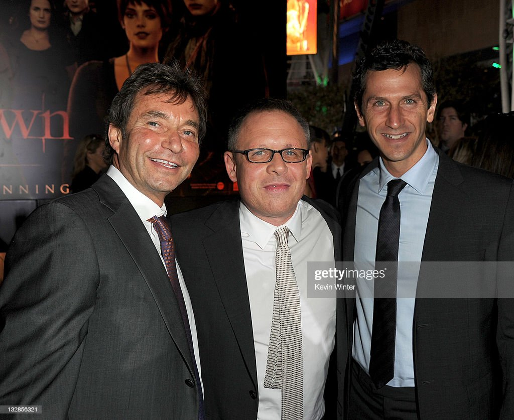 Summit Entertainment President & CEO Patrick Wachsberger, director Bill Condon, and Summit Entertainment President of Worldwide Production and Acquisitions Erik Feig arrive at the premiere of Summit Entertainment's 'The Twilight Saga: Breaking Dawn - Part 1' at Nokia Theatre L.A. Live on November 14, 2011 in Los Angeles, California.