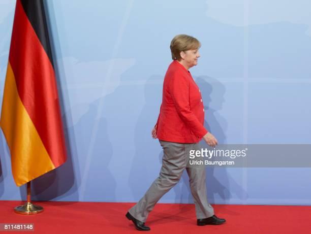 G20 summit in Hamburg Federal ChancellorAngela Merkel and the flag of Germany