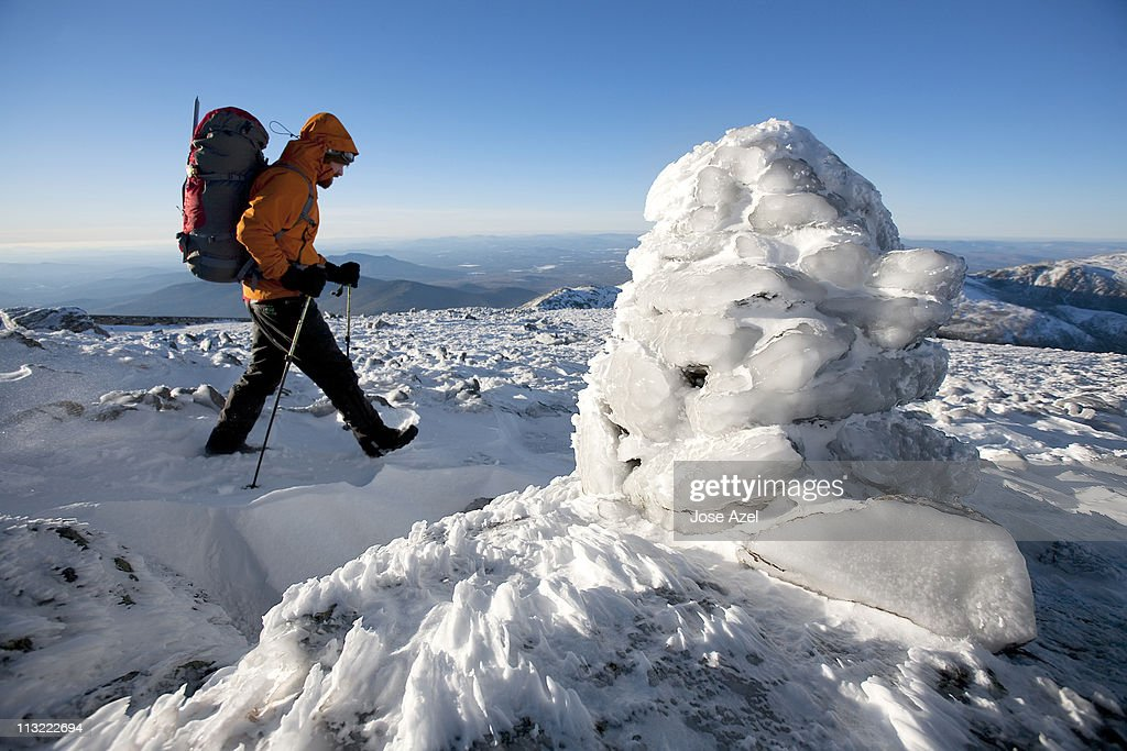 A Summit Intern hikes the northwest area of Mt. Washington's summit cone during some time off from his work.