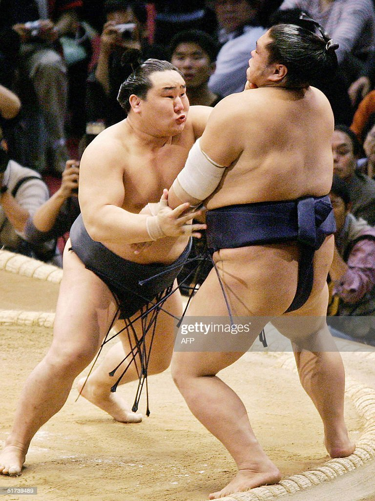 Sumo grand champion Asashoryu pushes Tochinonada out of the ring during the first day bout of the 15day long Kyushu Grand Sumo Tournament in Fukuoka...