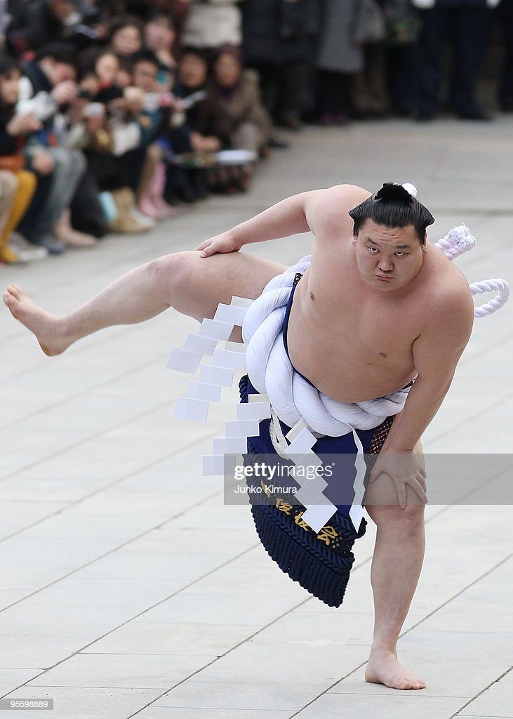 Sumo Grand Champion <a gi-track='captionPersonalityLinkClicked' href=/galleries/search?phrase=Hakuho&family=editorial&specificpeople=625611 ng-click='$event.stopPropagation()'>Hakuho</a> performs 'Dohyo-iri' (ring purification ritual) at the Meiji Jingu Shrine on January 6, 2010 in Tokyo, Japan. It is the custom that Sumo Grand Champions celebrate the new year by performing the ritual at the Meiji Jingu Shrine.