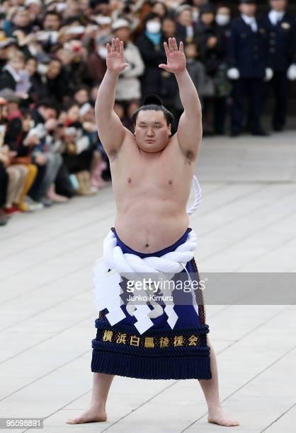 Sumo Grand Champion Hakuho performs 'Dohyoiri' at the Meiji Jingu Shrine on January 6 2010 in Tokyo Japan It is the custom that Sumo Grand Champions...