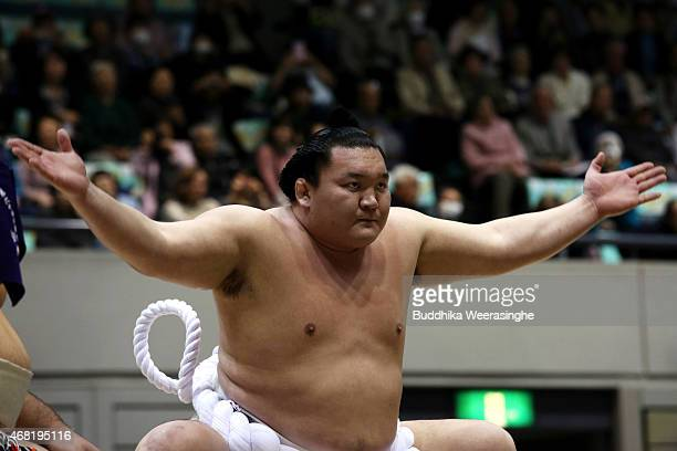 Sumo Grand Champion Hakuho Sho performs Dohyoiri the ringentering ceremony during the Grand Sumo Tournament at the Himeji Chuo Gymnasium on March 31...
