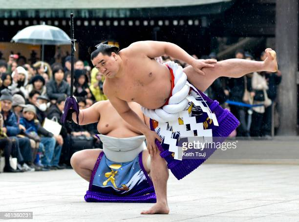 Sumo Grand Champion Harumafuji Kohei performs 'Dohyoiri' during Dezuiri ceremony at the Meiji Shrine on January 8 2014 in Tokyo Japan It is a custom...