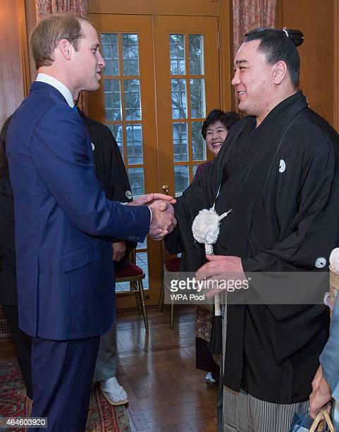 Sumo grand champion Harumafuji meets Prince William Duke of Cambridge at a reception at Togo Palace given by the Ambassador where he met high profile...