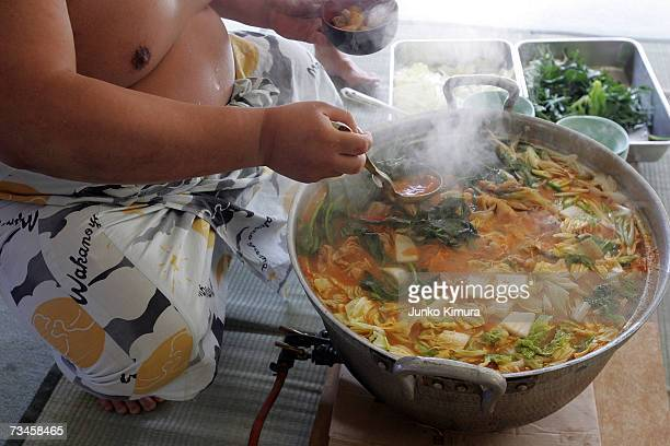 A sumo wrestler dishes up 'chankonabe' during a 'Sumo Diet Campaign' event at Musashigawa Sumo Stable on March 1 2007 in Osaka Japan The Sumo Stable...
