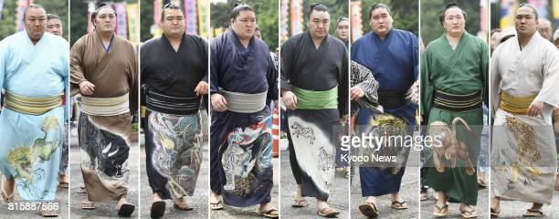 Sumo wrestlers Kotoyuki Okinoumi Kotoshogiku Goeido Harumafuji Terunofuji Chiyoshoma and Ishiura enter the venue of the Nagoya Grand Sumo Tournament...