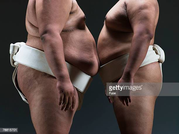 Sumo Wrestlers Standing Belly to Belly
