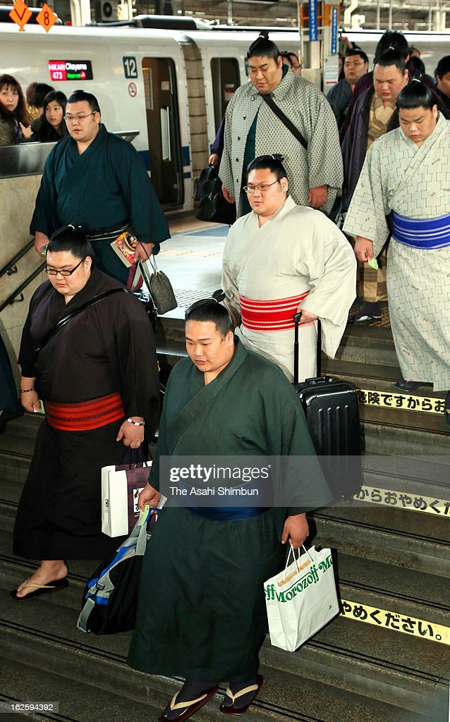 Sumo wrestlers walk down the stairs on arrival at Shin Osaka Station on February 24, 2013 in Osaka, Japan. Approximately 200 wrestlers arrive at Osaka in preparation for Grand Sumo Spring Tournament, starting on March 10.