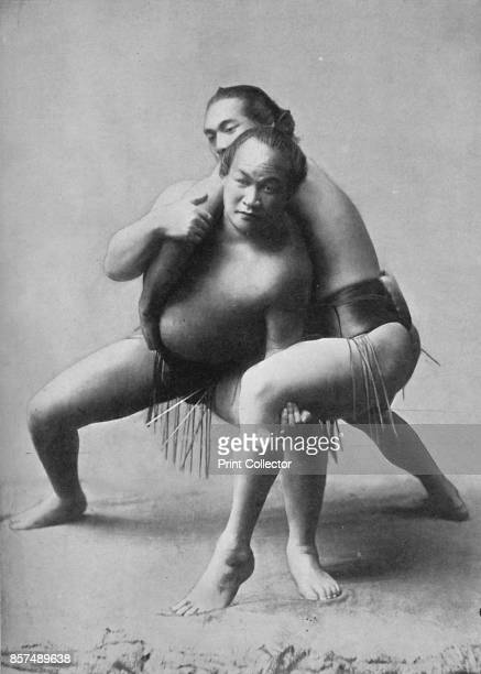 A sumo wrestling bout between a pair of Japanese professionals 1902 From The Living Races of Mankind Vol I [Hutchinson Co London 1902] Artist Unknown