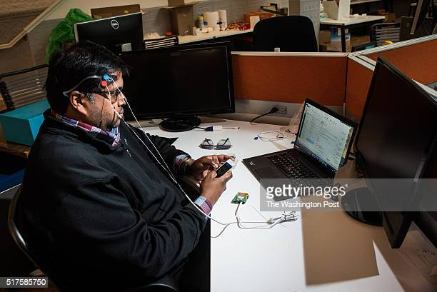 Sumon Pal Chief of Vibes at Thync tests a prototype Thync module at his desk at Thync's headquarters The module sends low energy waveforms that...