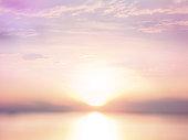 Abstract blur background of sun at sunset summer beach.