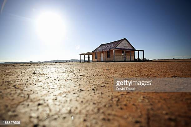 sun behind an outback shed