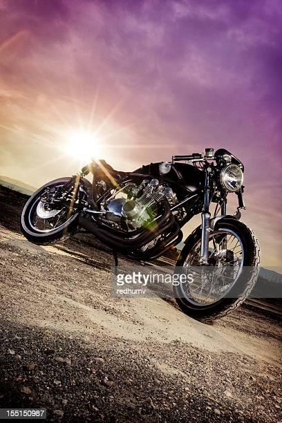 Sun bouncing off a retro Cafe Racer motorcycle