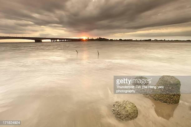 Sun burst upon a bridge at cloudy day
