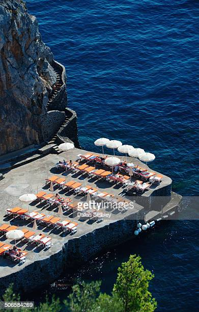 Sun deck on the rocks, near Positano, Italy