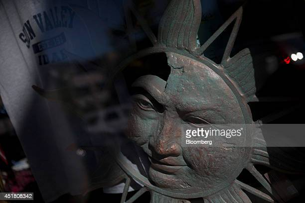 A sun decoration is displayed in the window of a gift shop ahead of the Allen Co Media and Technology Conference in Sun Valley Idaho US on Monday...