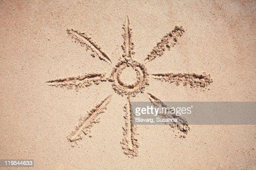 Sun drawing on sand : Stock Photo