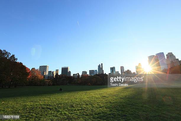 Sun going down to Manhattan skyline.