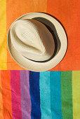 Sun hat on a beach towel