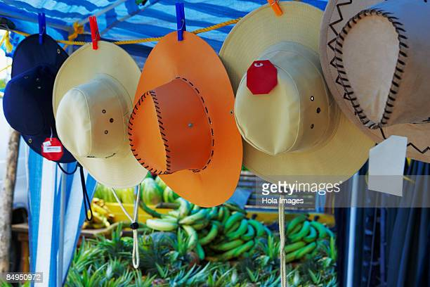 Sun hats hanging at a market stall, Puerto Rico