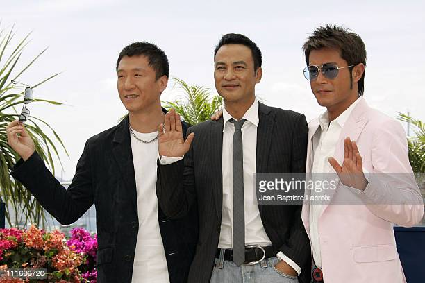 Sun Hong Lei Simon Yam and Louis Koo during 2007 Cannes Film Festival 'Triangle' Photocall at Palais des Festivals in Cannes France France