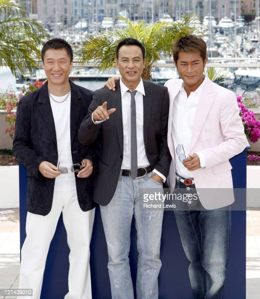 Sun Hong Lei Simon Yam and Louis Koo during 2007 Cannes Film Festival 'Triangle' Photocall at Palais de Festival in Cannes France