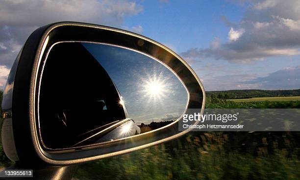 Sun in mirror of car