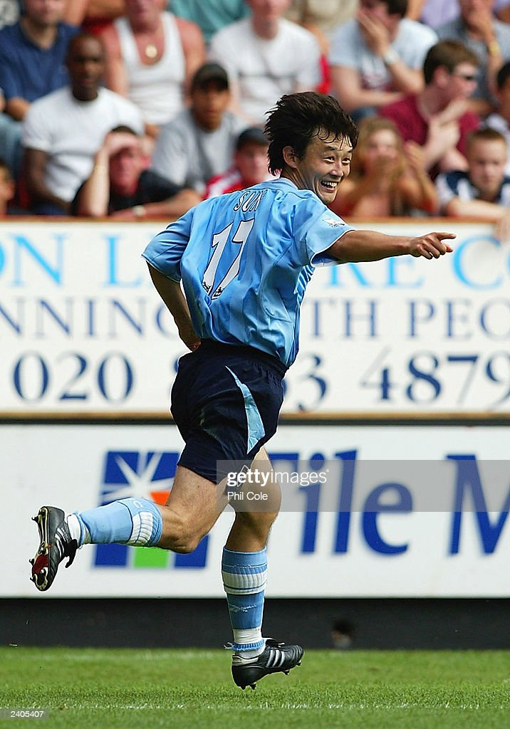 <a gi-track='captionPersonalityLinkClicked' href=/galleries/search?phrase=Sun+Jihai&family=editorial&specificpeople=228898 ng-click='$event.stopPropagation()'>Sun Jihai</a> of Manchester City celebrates scoring the third goal during the FA Barclaycard Premiership match between Charlton Athletic and Manchester City at The Valley on August 17, 2003 in London.