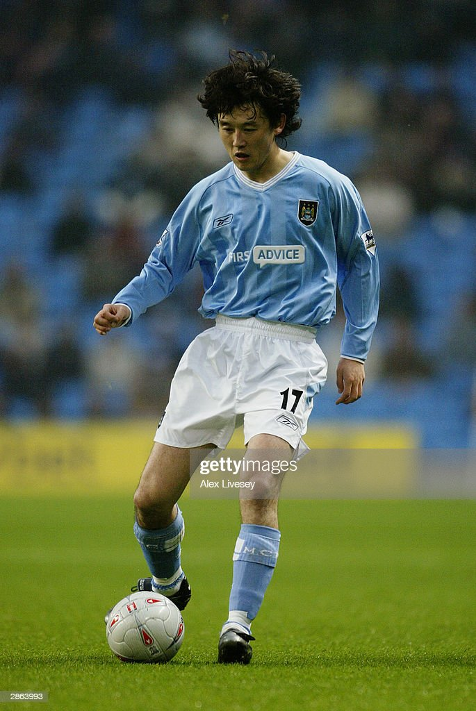 Sun Jihai of Manchester City passes the ball during the FA Cup third round match between Manchester City and Leicester City on January 3, 2004 at the City of Manchester Stadium in Manchester, England. The match finished in a 2-2 draw.
