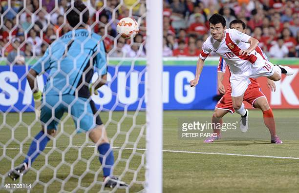 Sun Ke of China scores his second goal against North Korea during their Group B football match at the AFC Asian Cup in Canberra on January 18 2015...
