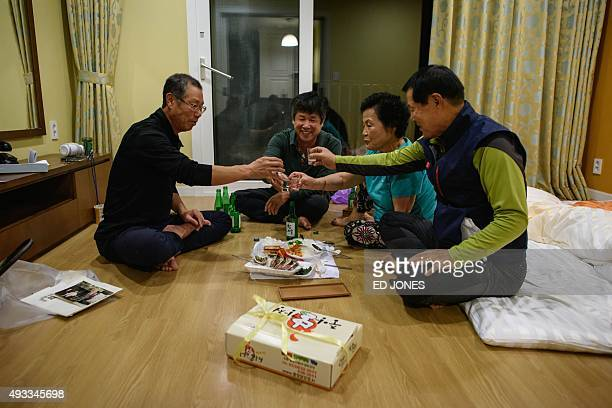 Sun KyeongSo and his wife Sun KeumSoon of Soth Korea drink a toast with their nephews the night before departing for a family reunion with their...