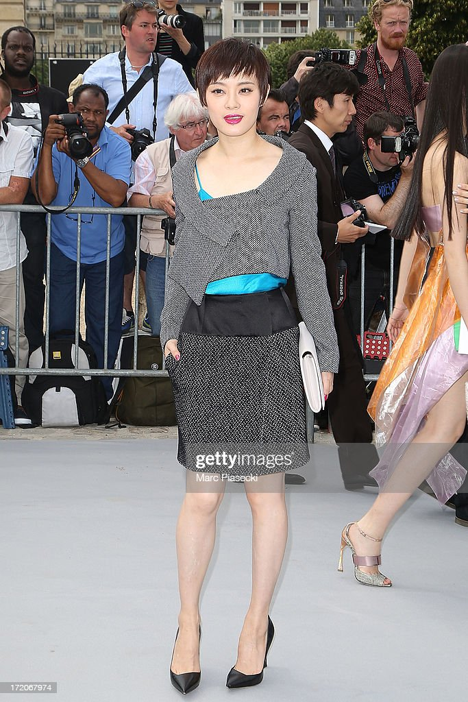 Sun Li arrives to attend the Christian Dior show as part of Paris Fashion Week Haute Couture Fall/Winter 2013-2014 at on July 1, 2013 in Paris, France.