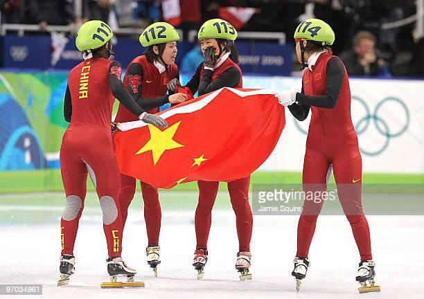 Sun Linlin Wang Meng Zhou Yang Zhang Hui and Wang Meng of Team China celebrate winning the gold medal in the Short Track Speed Skating Ladies' 3000m...