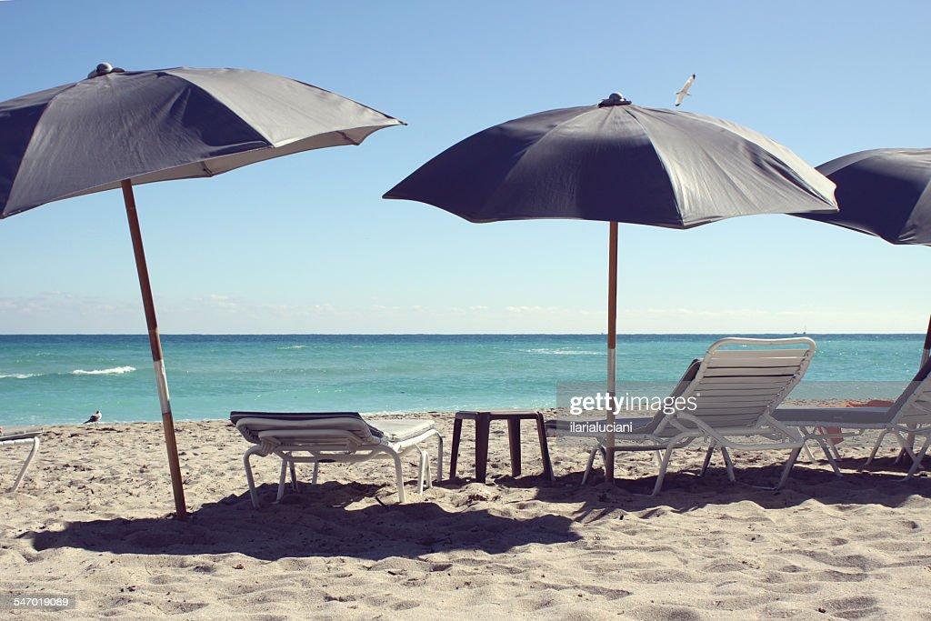 Sun loungers and beach umbrellas, South Beach, Florida, USA