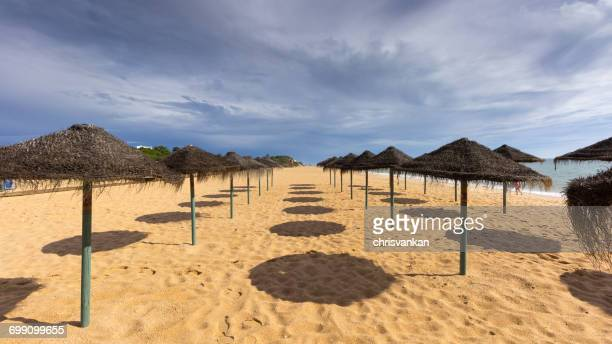 Sun loungers and parasols on the beach, Algarve, Portugal