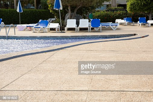 Sun Loungers Beside A Swimming Pool Photo Getty Images