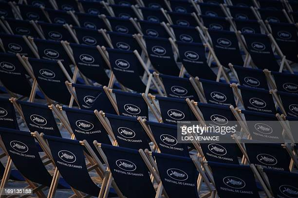 Sun loungers with the logo of the palm are set to watch movies on the beach as part of the 'Cinema de la Plage' screenings during the 66th Cannes...